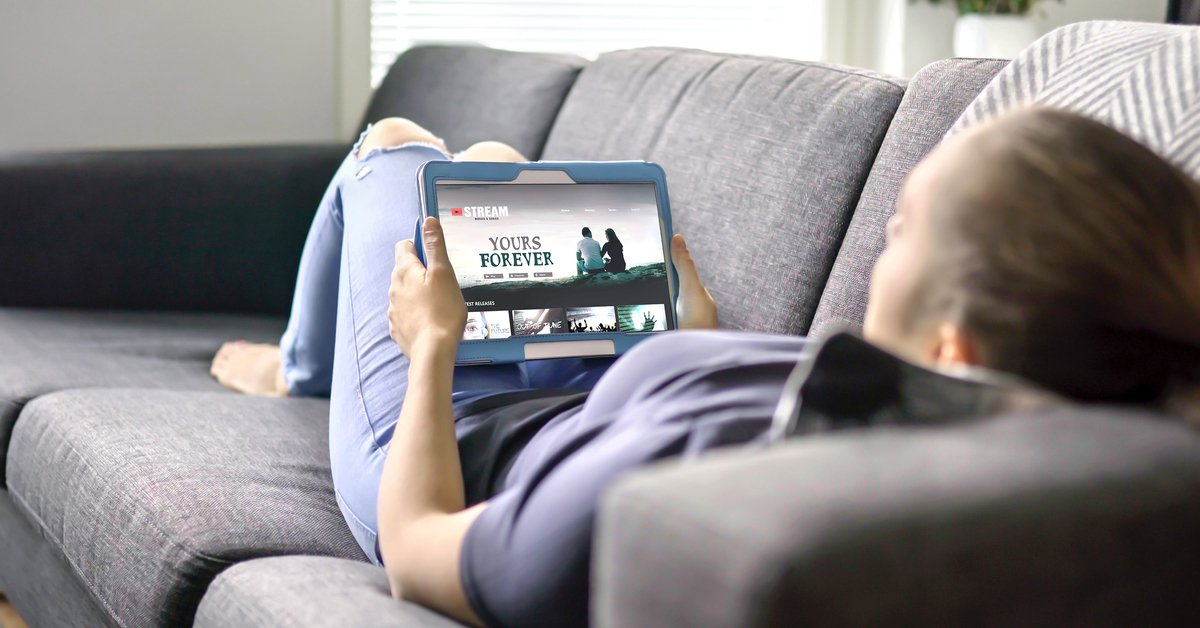 Woman watching movie on streaming platform